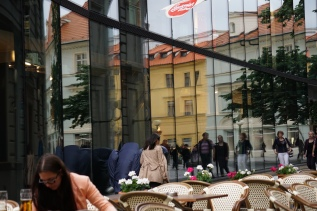 Cafe and reflections in window, Prague