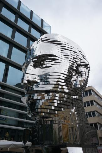 Rotating sculpture of man's head, Prague