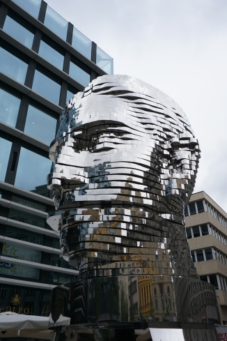 Rotating sculpture of man's head, Prague