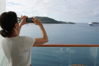JoAnn taking a photo of the Grandeur sailing into St. Thomas